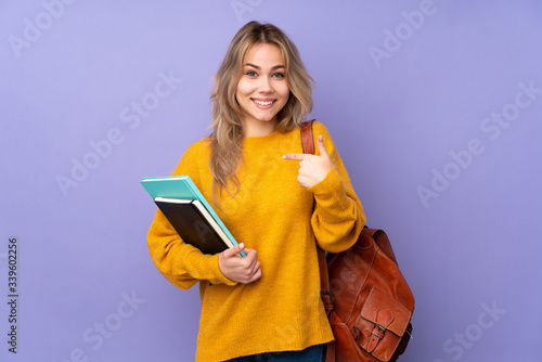 Fotografija Teenager Russian student girl isolated on purple background with surprise facial