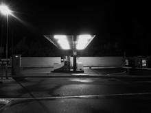 Illuminated Gas Station At Roadside
