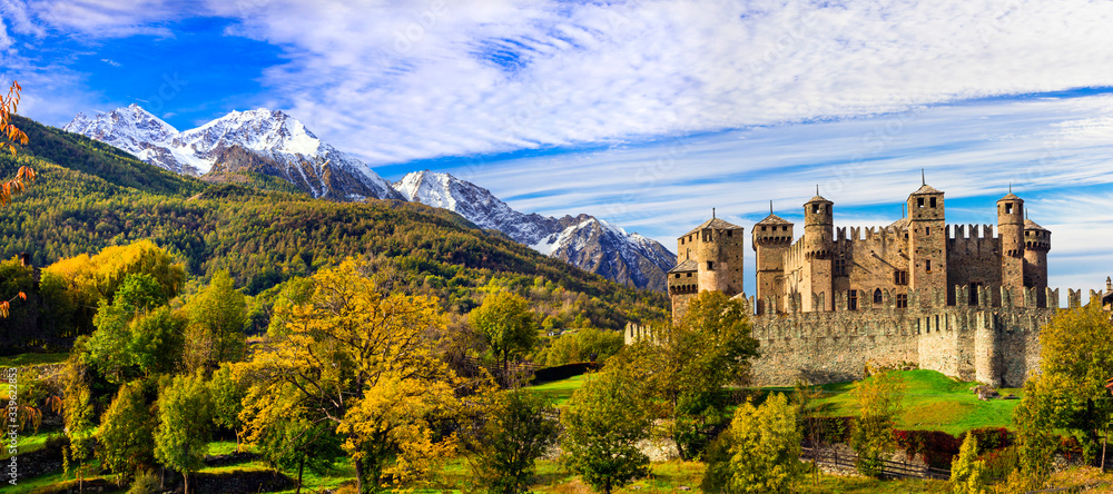 Fototapeta Medieval castles of Italy - beautiful Castello di Fenis in Valle d'Aosta surrounded by Alps mountains