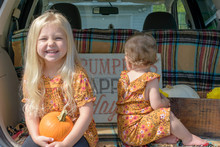 Cute Little Blonde Girl Sittin...
