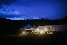 Greenhouse And Tent At Night