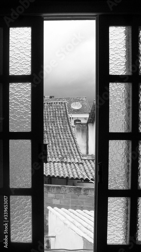 Houses Seen Through Ajar Window Canvas Print