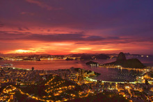 High Angle View Of Illuminated Residential District And Guanabara Bay At Dusk