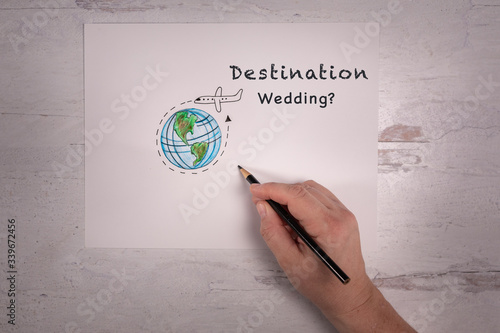 Wedding and travel industry sign destination wedding? with hand doodle of world Fototapete
