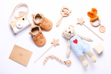 Set Of Baby Shoes, Toys And Accessories On White Background. Newborn Stuff. Flat Lay, Top View