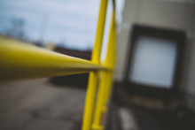 Close-up Of Yellow Metallic Railing At Commercial Dock
