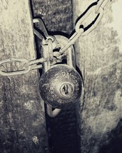 Close-up Of Padlock On Old Door