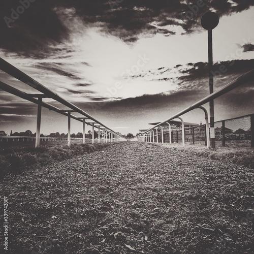 Carta da parati Empty Horseracing Track Against Sky