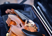 Violin And Bow Resting In Case