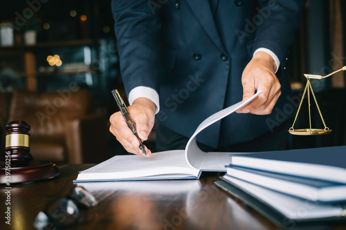 Fototapety, obrazy: Partner lawyers or attorneys discussing a contract agreement. Successful businessmen hand putting signing contract,have a contract in place to protect it,signing of modest agreements form in office.