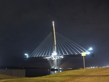 Low Angle View Of Illuminated Incomplete Queensferry Crossing At Night