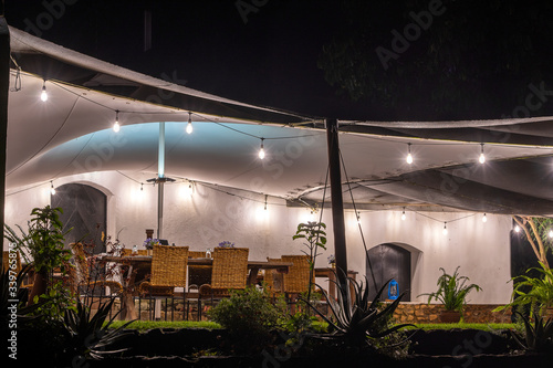 Empty restaurant terrace with tables and rattan chairs in evening фототапет
