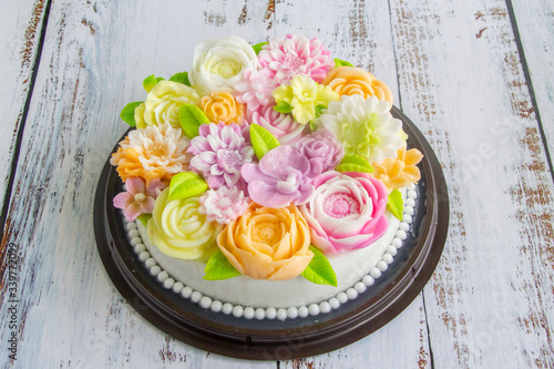 jelly cake or Agar agar cake decorate with soft colorful flower on top Canvas Print