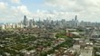 Chicago Neighborhood on Warm Summer Afternoon with City Skyline in Background, Aerial, Pan Down