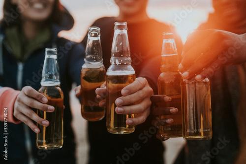 Fototapeta Friends drinking by the beach