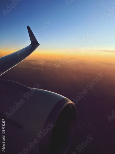 Cropped Image Of Airplane Wing Over Landscape Fototapet