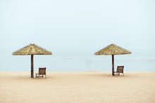Lounge Chairs By Thatched Roof...