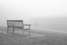 Empty Bench Overlooking Calm Sea