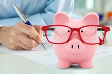 Cute Piggy Bank In Glasses On ...