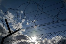 Low Angle View Of Silhouette Barbed Wire Fence Against Sky