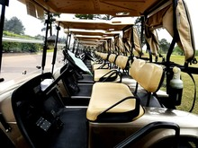 Golf Carts Parked In A Row