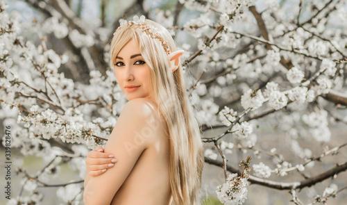 Fototapeta Elf woman in garden, cosplay, Halloween, ideas