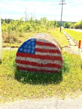 American Flag On Hay Bale At G...