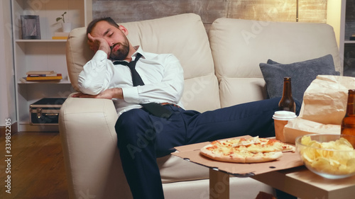 Overworked businessman sleeping on the couch Fototapet