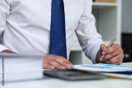 Fototapety, obrazy: Clerk man at office workplace with silver pen in arms do paperwork closeup. Staff dress code worker job offer client visit study profession boss market idea coach training