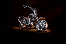 Motorcycle On A Black Background Under Lighting