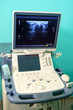 Ultrasound device for testing sonogram. Clinic interior. Sonography. Health tests concept. Closeup