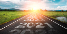 2020-2025 Written On Highway Road In The Middle Of Empty Asphalt Road At Golden Sunset And Beautiful Blue Sky. Concept For New Year 2022.