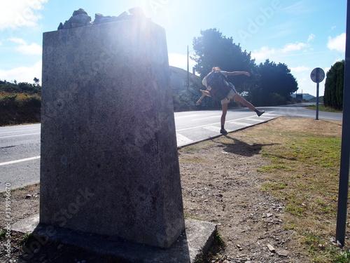 Fotografia Pilgrim on the road to Santiago de Compostela, Camino de Santiago, Way of St