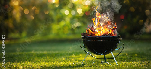 Leinwand Poster Barbecue Grill with Fire on Open Air. Fire flame