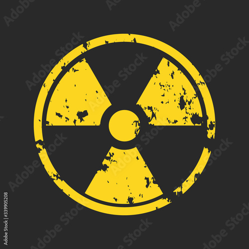 Obraz na plátně Vector illustration of grunge yellow radioactive hazard warning sign painted over black background