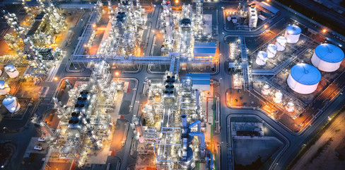 Large oil refinery industrial estates. Fuel refinery industry at night