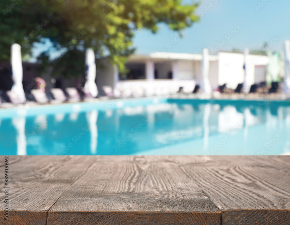 Fototapeta Wooden deck near swimming pool outdoors on sunny day. Space for text
