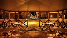Wooden Benches In Gazebo At Night