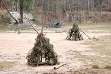 Two Tepees Built With Twigs An...