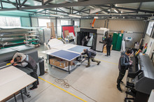Large Group Of Technicians Wor...