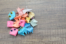 Origami Croaking Frogs On Wooden