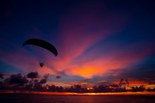 Silhouette Of Paramotor Flying...