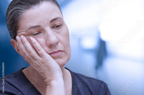 Fibromyalgia symptom fatigue: very tired woman nearly falling asleep in the offi Wallpaper Mural
