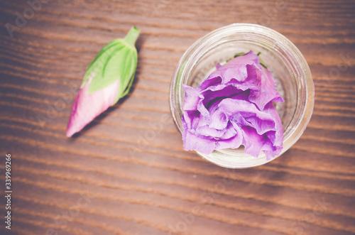 Fototapeta High Angle View Of Purple Flower In Vase On Wooden Table obraz