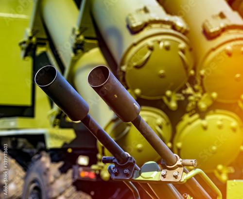 Photo Heavy machine gun antiaircraft defense on background of antiaircraft missile com
