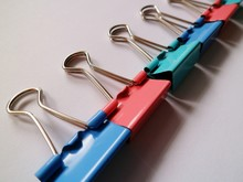 Close-up Of Binder Clips On Table