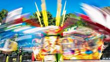 Blurred Motion Of Illuminated Carousel At Night