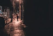 Shadowy Figure Walking Down St...