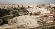 Aerial view of ruins of ancient Roman amphitheater in Spanish city of Tarragona