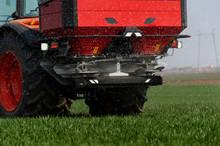 Tractor Spreading Artificial F...